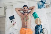 Handsome Young Bearded Man With Nude Chest Smiling, Lying On Bed, Going To Pack To A Trip, Journey.  poster