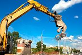 foto of crusher  - Commercial and Industrial Demolition with Hydraulic Concrete Crushers - JPG