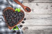 Ripe Blackberry And Blackberry Jam On A Wooden Table. Top View. poster