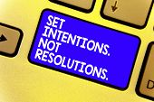 Word Writing Text Set Intentions. Not Resolutions.. Business Concept For Positive Choices For New St poster