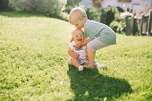 Happy Children Play On Nature Outdoors. Brother And Sister. poster