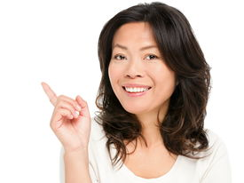 stock photo of early 50s  - Pointing showing Asian woman - JPG