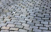 foto of olden days  - Uneven cobblestone walkway that reminds people of old charm and history. ** Note: Shallow depth of field - JPG