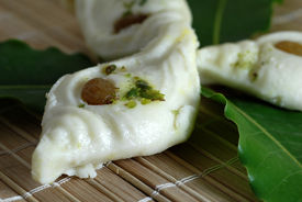 picture of mishti  - A closeup shot of a white Indian sweet made from milk - JPG