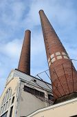 Industrial Building And Two Brick Chimney