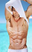 stock photo of arm muscle  - Vibrant fashion portrait of a sexy muscular fit man - JPG
