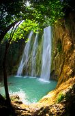 stock photo of cataract  - waterfall in deep green forest - JPG