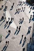 stock photo of pedestrians  - people walking in a pedestrian area seen from birds view looking antlike - JPG