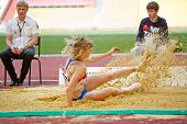 MOSCOW - JUN 11: Female jumper in sandpit at Grand Sports Arena of Luzhniki OC during International