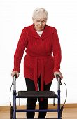pic of rollator  - Elder disabled woman is walking with walker - JPG
