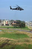 stock photo of katrina  - a military helicopter takes off from interstate 10 near new orleans during rescue operations after hurricane katrina flooded new orleans - JPG