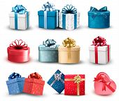 stock photo of bowing  - Set of colorful gift boxes with bows and ribbons - JPG