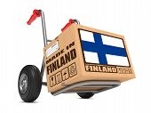pic of free-trade  - Cardboard Box with Flag of Finland and Made in Finland Slogan on Hand Truck White Background - JPG