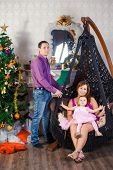 pic of cozy hearth  - Family before Christmas fireplace in the decorations - JPG