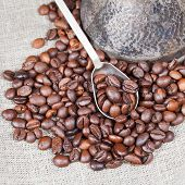 picture of pot roast  - roasted coffee beans and copper coffee pot close up on textile - JPG