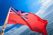 Uk Ensign British Maritime Flag Of Yacht Sailboat Blue Sky Sea. Sailing.