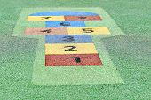 picture of hopscotch  - hopscotch painted on the floor in a child park - JPG