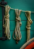 stock photo of stagecoach  - Wild West Scene Of Ropes On The Side Of An Old Wagon - JPG