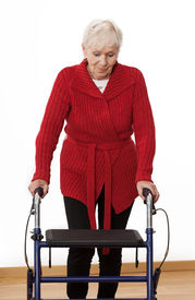 stock photo of rollator  - Elder disabled woman is walking with walker - JPG