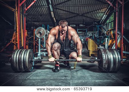 Powerlifter with strong arms lifting weights poster