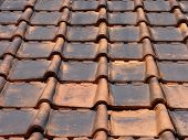 foto of red roof tile  - A View Of Dirty Red Tiles Roof Background