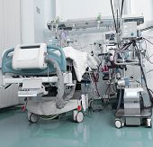 stock photo of icu  - ICU with serious patient in the ward - JPG