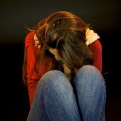 stock photo of rape  - Sad victim of sexual abuse crying in black background - JPG