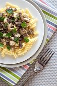 stock photo of morel mushroom  - Top view on plate with spiral pasta with morel mushrooms - JPG