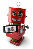 image of toy phone  - Happy vintage toy robot with smartphone and thumbs up over white background - JPG