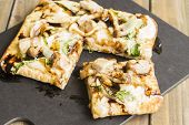 image of sauteed  - Chia flatbread topped with creamy bechemel sauce arugula smoked havarti cheese sauteed hamakua mushrooms sweet Maui onion and smoked Ahi tuna drizzled with balsamic reduction - JPG