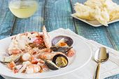 stock photo of cooked blue crab  - Seafood stew made with lobster crab shrimp and clams cooked in coconut milk with tomatoes and onions - JPG