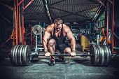 stock photo of dumbbells  - Powerlifter with strong arms lifting weights - JPG
