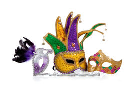 stock photo of mardi gras mask  - Several mardi gras masks with gold purple green and white with copy space on a white background - JPG