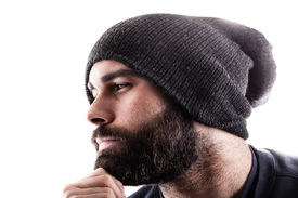 stock photo of runaway  - portrait of a thinking man with a beany and a beard maybe a rapper or a gangster - JPG