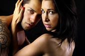 pic of intimacy  - passionate couple who embraces on a black background - JPG