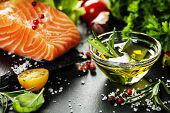image of slating  - Delicious  portion of fresh salmon fillet  with aromatic herbs - JPG