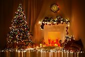 stock photo of xmas star  - Christmas Room Interior Design Xmas Tree Decorated By Lights Presents Gifts Toys Candles And Garland Lighting Indoors Fireplace - JPG
