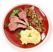 foto of lamb chops  - Lamb chops cut from a roast lamb rack and served with creamed garlic potato and onion relish - JPG