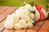 picture of rosa  - Beautiful bouquet of white roses on wooden floor - JPG