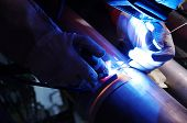 stock photo of tig  - welding of titanium pipes in inert gas - JPG