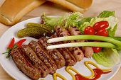 foto of scallion  - Grilled sausages with red hot chilli peppers - JPG