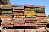stock photo of scaffold  - multicolor scaffolding planks for construction and industrial - JPG