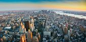 image of empire state building  - Aerial panoramic wide angle view over lower Manhattan New York from Empire State building top at sunset in 2007 - JPG