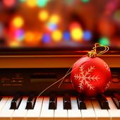picture of christmas bells  - Christmas ball on piano keys - JPG