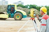 picture of geodesic  - One surveyor worker working with theodolite transit equipment at road construction site outdoors - JPG