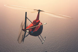 picture of helicopters  - Civilian helicopter over the sea - JPG
