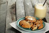 stock photo of condensation  - Cookies on plate with jar of condensed milk on wooden background - JPG