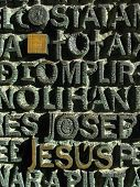 picture of carving  - Carved lettering Jesus and cube on the doors of  The temple of  Sagrada Familia - JPG