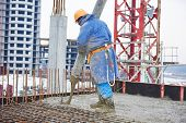 image of concrete  - construction site worker at concrete works at building area  - JPG