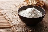 picture of sackcloth  - Flour in bowl with ears and grains on sackcloth background - JPG